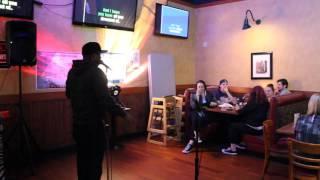 Karaoke singer singing I Will Always Love You by