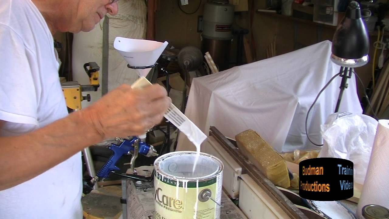 mixing paint filling a spray gun small shop spray. Black Bedroom Furniture Sets. Home Design Ideas