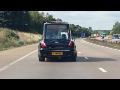 Hearse on the motorway to music.