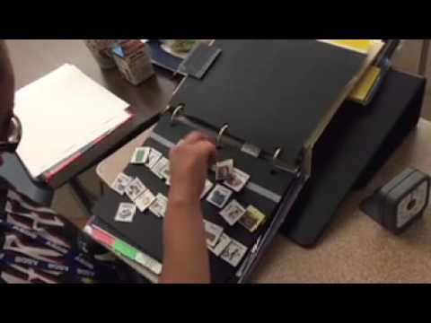 Student Using Picture Symbols In Three Ring Binder