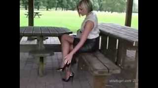 Repeat youtube video Leggy Blonde Outdoors wearing Black Leather Skirt Black Pantyhose and Black High Heels