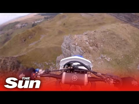 Tanner and Drew - Dirt Biker Rides Off 40 Foot Cliff And Survives