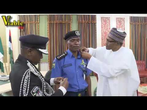 Just In : Buhari Decorates New IGP Abubakar Adamu