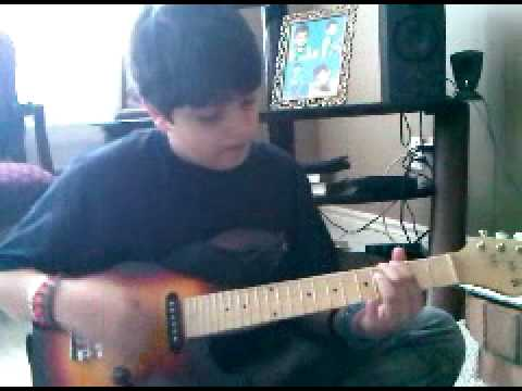 me-playing-the-dx-theme-on-my-guitar