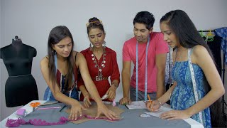 A young group of hardworking students attending fashion studies workshop - creative education