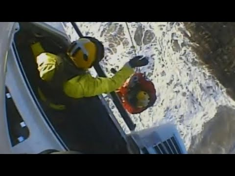 Coastguard Fights 6-Foot Waves In Dramatic Rescue of Two Men Stranded on Rocks