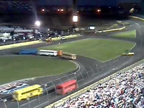 School bus racing on big money 100 night with fire for Charlotte motor speedway driving school