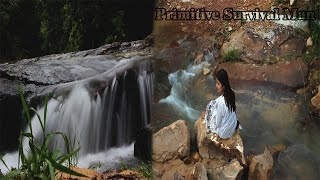 The woman travel in the forest and visited the water fall
