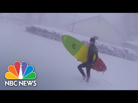 Surfers Hit Lake Erie During Lake Effect Snow Storm | NBC News