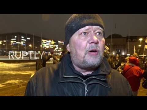 Finland: Anti-immigration protesters march past refugee camp in Helsinki