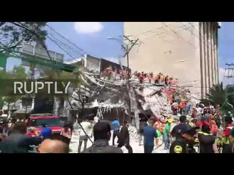 Mexico: Rescue workers attend scene of decimated building in capital