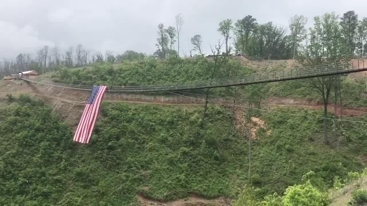 Gatlinburg Skybridge reopens, waves massive American Flag for ...