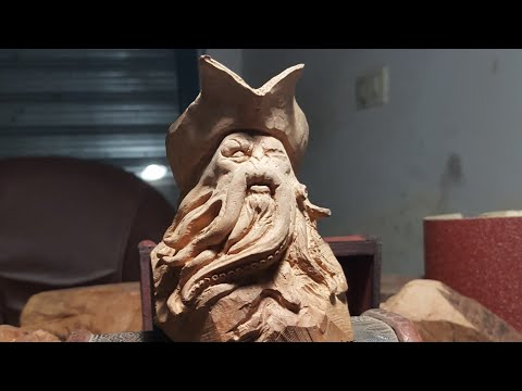 #art Carving a  wooden Davy Jones as smoking pipe