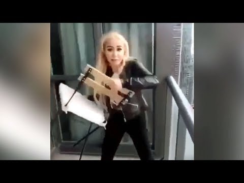 Woman accused in Toronto balcony chair-tossing incident released on bail