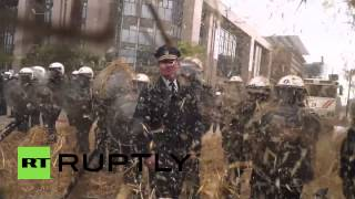 Belgium: Farmers cover police in burning hay at Brussels protest