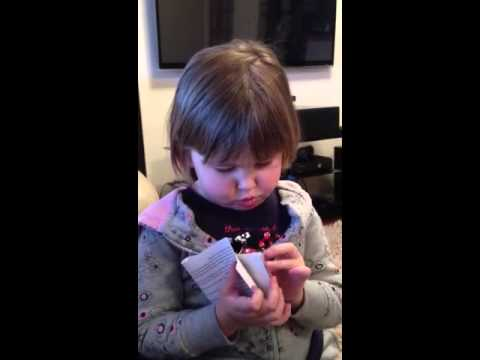 Toddler reads camera instruction book