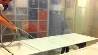 Spraying kitchen cabinets white with airless sprayer in garage