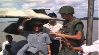 Crewmen aboard a Patrol Boat River inspect papers of civilians during Operation G...HD Stock Footage
