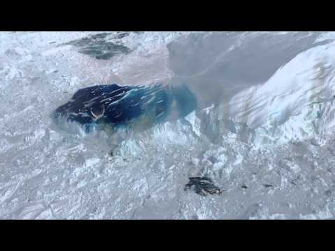 World's fastest glacier. Calving enormous iceberg in Greenland.