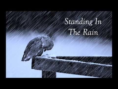 Sad instrumental music standing in the rain