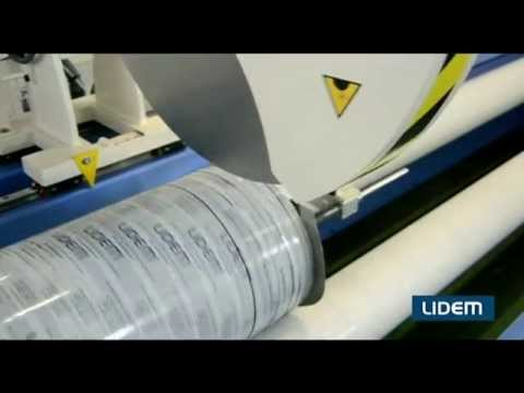 Automatic roll cutter or slitter for fabrics, nonwoven, paper and cardboard