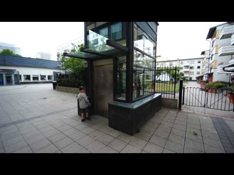 Sweden, Stockholm, Tumba Centrum / bus exchange, escalator and  HissPartner AB elevator