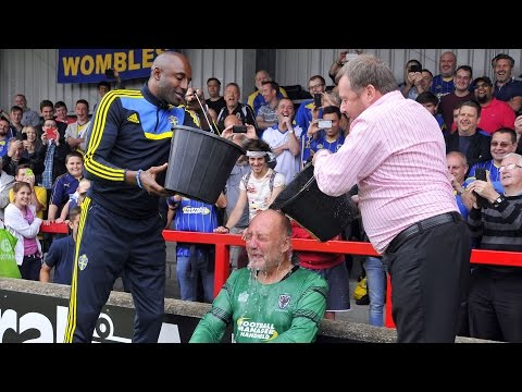 Dickie Guy gets a soaking at AFC Wimbledon