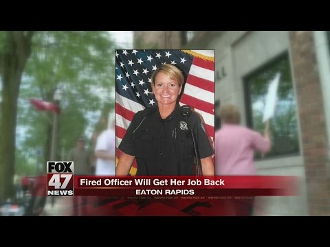 Fired officer to get her job back