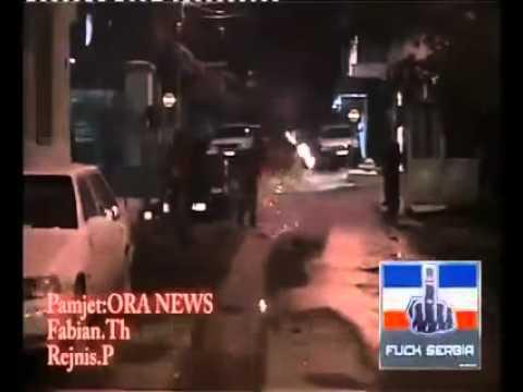 Albanians burn Serbian flag