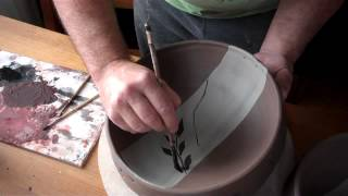 pottery brush decorating bowls, ready for oribe glazing