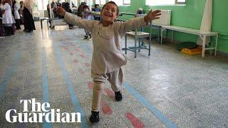 Beaming young Afghan amputee dances on new prosthetic leg