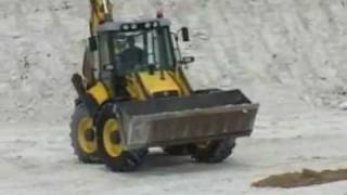 New Holland LB115.wmv