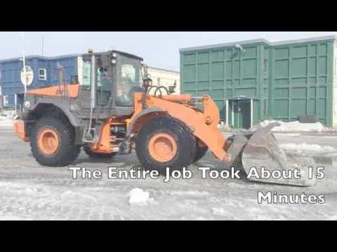 Cleaning Slush in Greenland