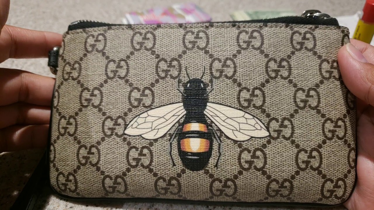 a487fb90dc7a16 What's in my Gucci Supreme Bee Wristlet?! - YouTube