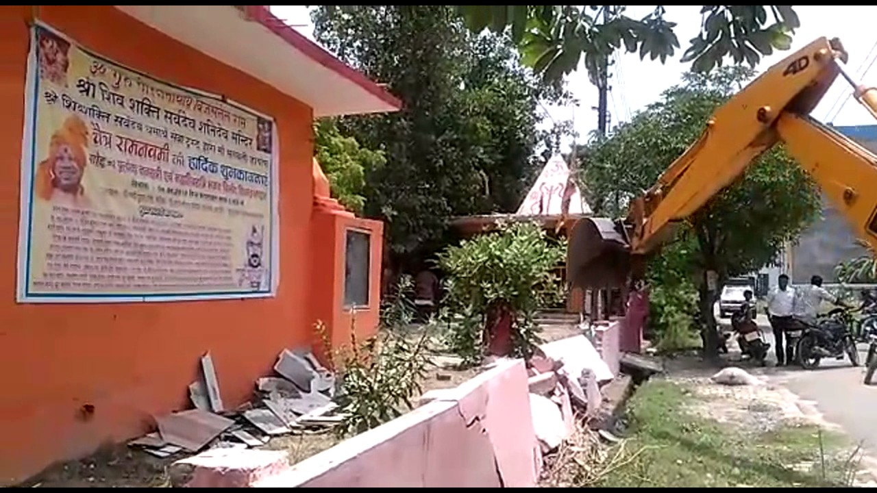 JCB runs on the wall of the temple built by encroachment