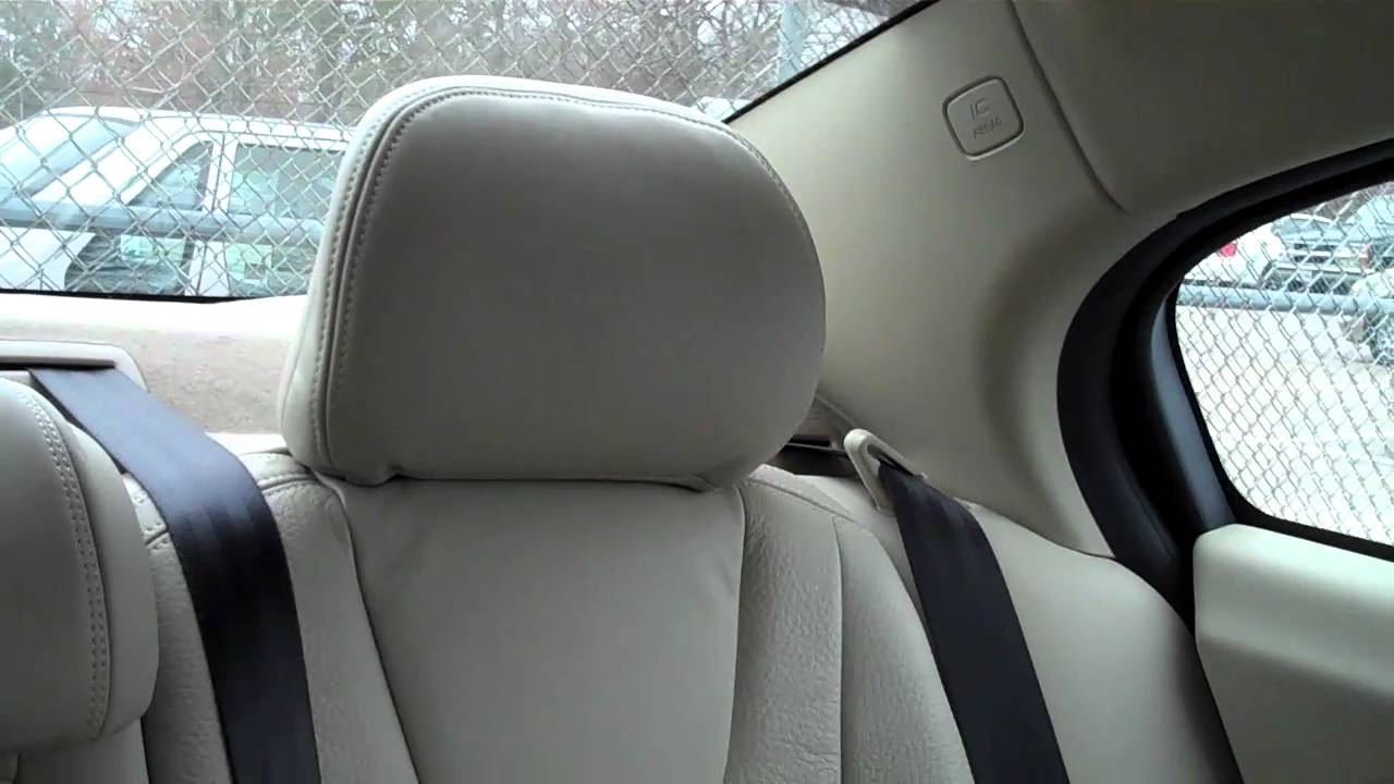 Buick Regal: Head Restraint Removal and Reinstallation