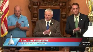 Sen. Bumstead welcomes the state champion Mona Shores football team to the Michigan Senate