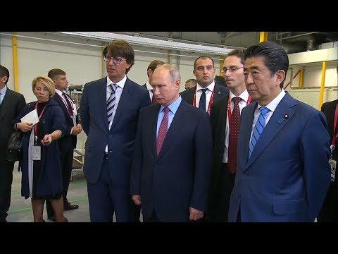 Putin and Abe visit Mazda plant in Russia's Vladivostok