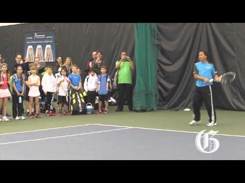 Tennis legend Michael Chang gives a clinic