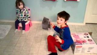 Conner helps potty train his sister