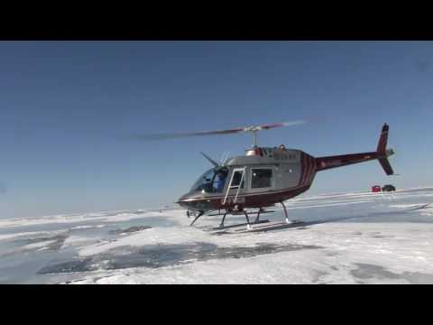 Helicopter ice fishing for walleyes on lake winnipeg youtube for Lake winnipeg fishing report