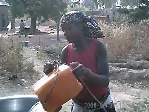 Kande Togo Girl Pulling Water from Water Well to Carry to Home