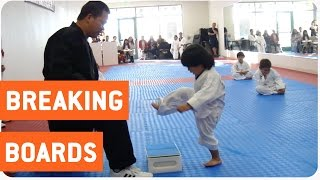 Little Boy Trying to Break Board in Taekwondo | The New Karate Kid(This little boy is trying to break a board as part of the Taekwondo white belt inauguration. After struggling several times to break the board and failing, ..., 2015-08-10T17:03:33.000Z)