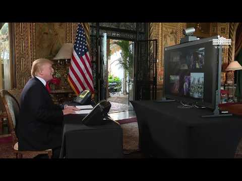 President Trump participates in a Christmas Eve video teleconference with members of the military