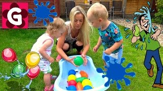 Kids and Mommy playing Water Balloon Fight - Family Fun Time
