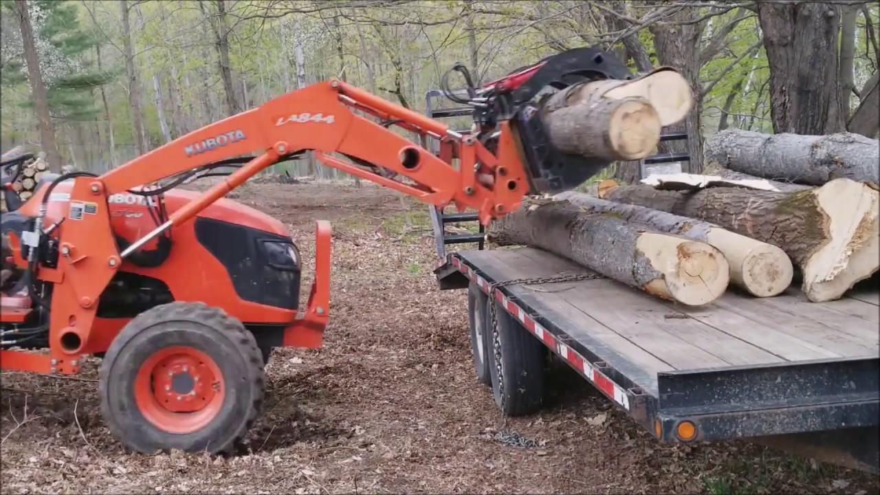 log loading with Kubota and grapple