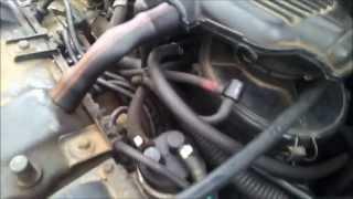 Bruit d'air qui sort d'un tuyau du moteur 106 essence année 93 anormal ou pas ?