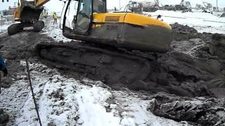 Elsüllyedt munkagépek (Sárban parkoló markoló)