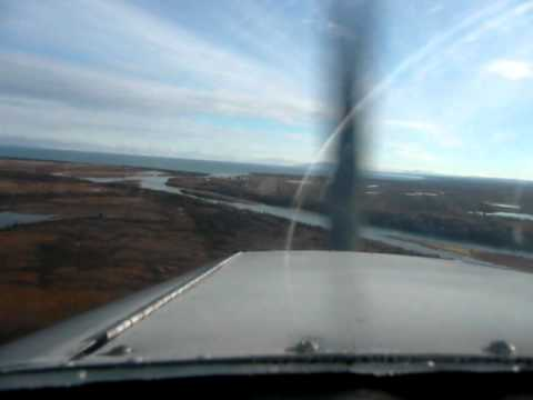 Father Scott J Garrett Landing in Igiugig, Alaska