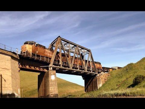 UNION PACIFIC diesel triplets lead a coal hopper rake over Altamont Pass, California